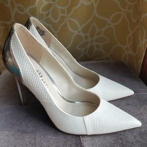 White and silver stiletto heels